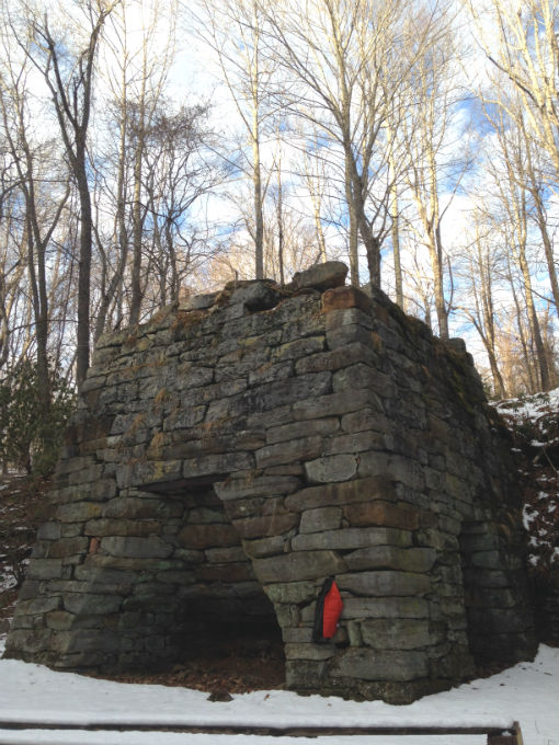 Furnace once used to make iron for pots and pans. Located next to and under Old Furnace Rd. SW. Truncated pyramid.