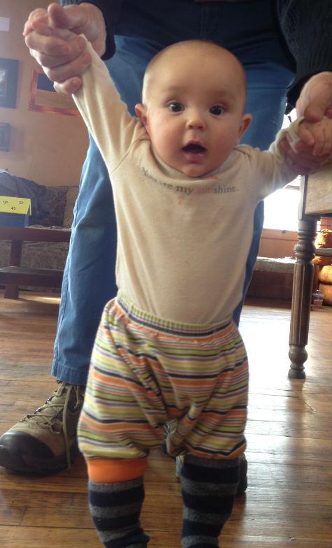 Samuel Hope Wells tries socks on slats, February 2015.